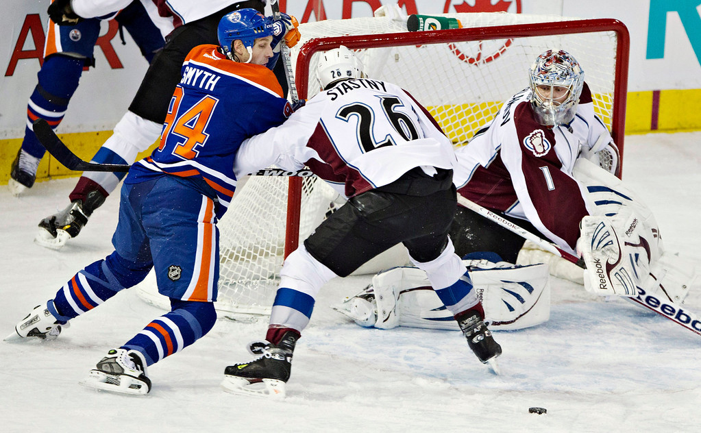 . Colorado Avalanche goalie Semyon Varlamov makes the save as Paul Stastny (26) and Edmonton Oilers\' Ryan Smyth battle for the rebound during the first period of their NHL hockey game, Monday, Jan. 28, 2013, in Edmonton, Alberta. (AP Photo/The Canadian Press, Jason Franson)