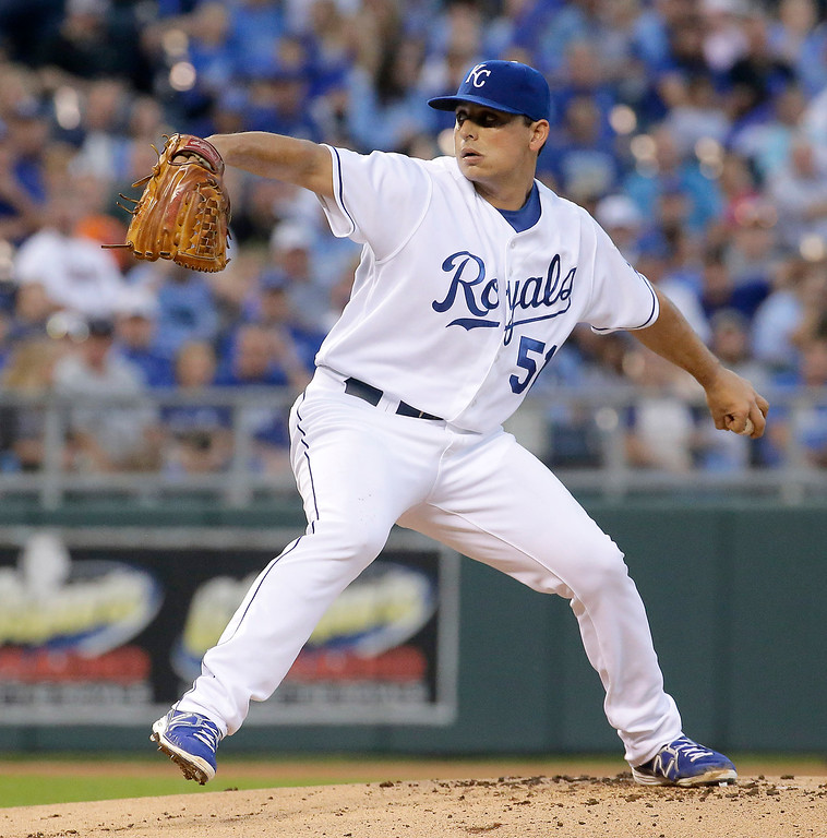 . Kansas City Royals starting pitcher Jason Vargas throws during the first inning of a baseball game against the Detroit Tigers on Friday, Sept. 19, 2014, in Kansas City, Mo. (AP Photo/Charlie Riedel)