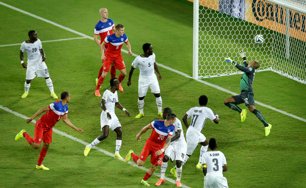 Description of . United States' John Brooks, second from left, scores his side's second goal during the group G World Cup soccer match between Ghana and the United States at the Arena das Dunas in Natal, Brazil, Monday, June 16, 2014. (AP Photo/Hassan Ammar)