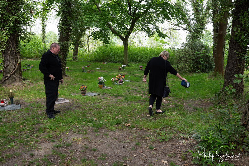 Ingrid spreading her Mother's ashes at the Bitterfeld Cemetary.