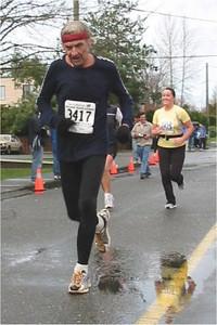2003 Comox Valley Half Marathon - Rintje Raap avoids a puddle