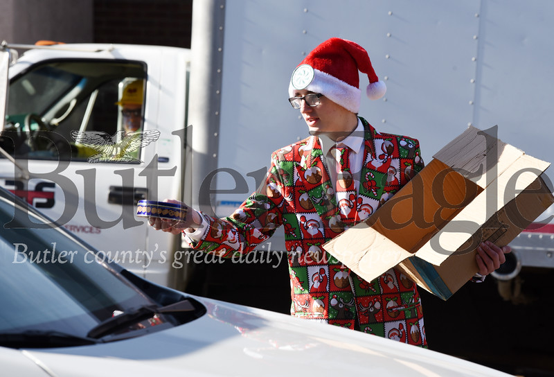 Harold Aughton/Butler Eagle: Ian Robb hands out Christmas cookies on behalf of the Center for Community Resources Monday, December 23, 2019.