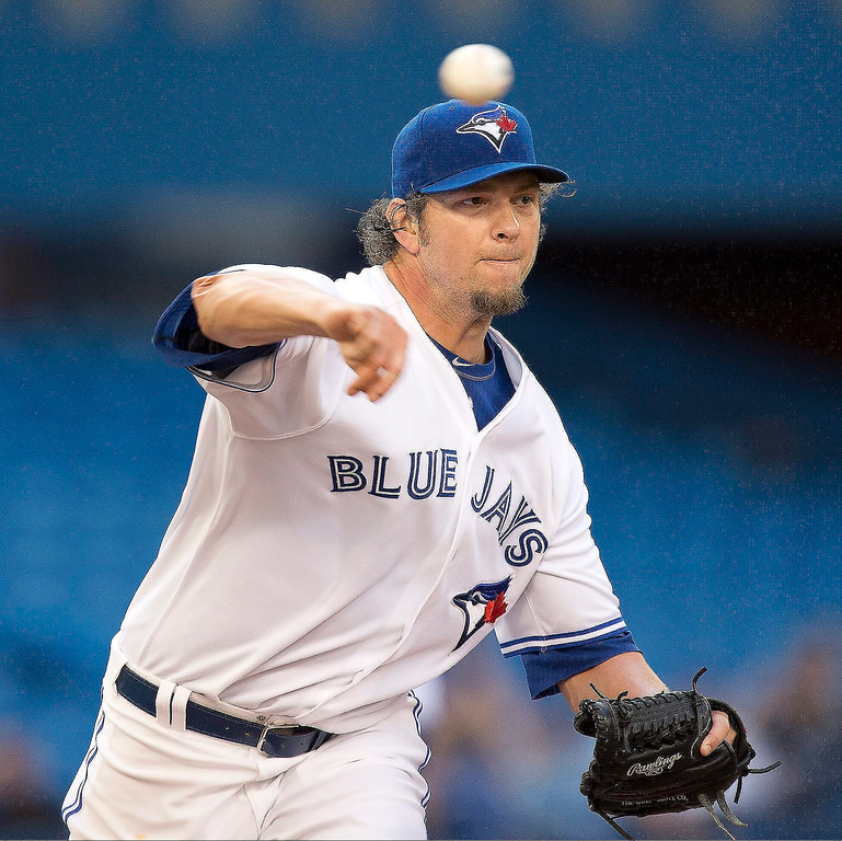 . Toronto Blue Jays pitcher Josh Johnson works against the Colorado Rockeis in the first inning of a baseball game in Toronto, Monday June 17, 2013.  (AP Photo/The Canadian Press, Frank Gunn)