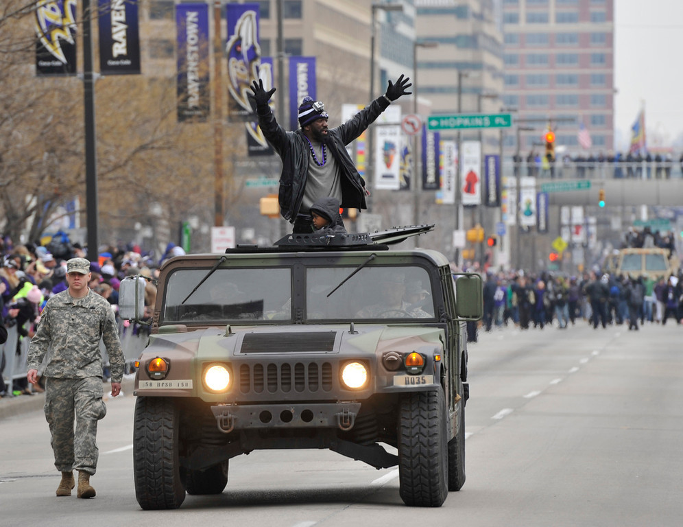 . Baltimore Ravens safety Ed Reed greets fans while riding in a Humvee during the Ravens victory parade Tuesday, Feb. 5, 2013, in Baltimore. The Ravens defeated the San Francisco 49ers in NFL football\'s Super Bowl XLVII 34-31 on Sunday. (AP Photo/Gail Burton)