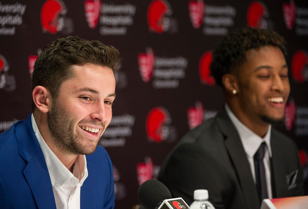 . Cleveland Browns first-round draftees, Baker Mayfield, left, and Denzel Ward laugh during an NFL footbal news conference at the team\'s headquarters in Berea, Ohio, Friday, April 27, 2018. (AP Photo/Phil Long)