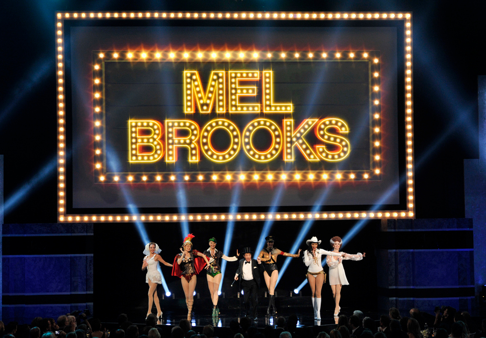. Martin Short and dancers perform a musical tribute to honoree Mel Brooks during the American Film Institute\'s 41st Lifetime Achievement Award Gala at the Dolby Theatre on Thursday, June 6, 2013 in Los Angeles. (Photo by Chris Pizello/Invision/AP)