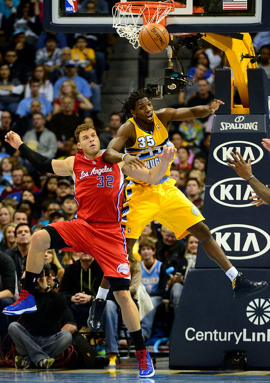 . ,Denver Nuggets small forward Kenneth Faried (35) and Los Angeles Clippers power forward Blake Griffin (32) battle for position during the second half of the Nugget\'s 92-78 win at the Pepsi Center on Tuesday, January 1, 2013. AAron Ontiveroz, The Denver Post