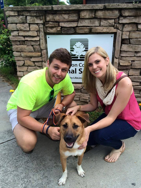"""Alex, """"Socks"""" (now Moxie) and GPB staffer Lauren Anderson at Fulton County Animal services"""