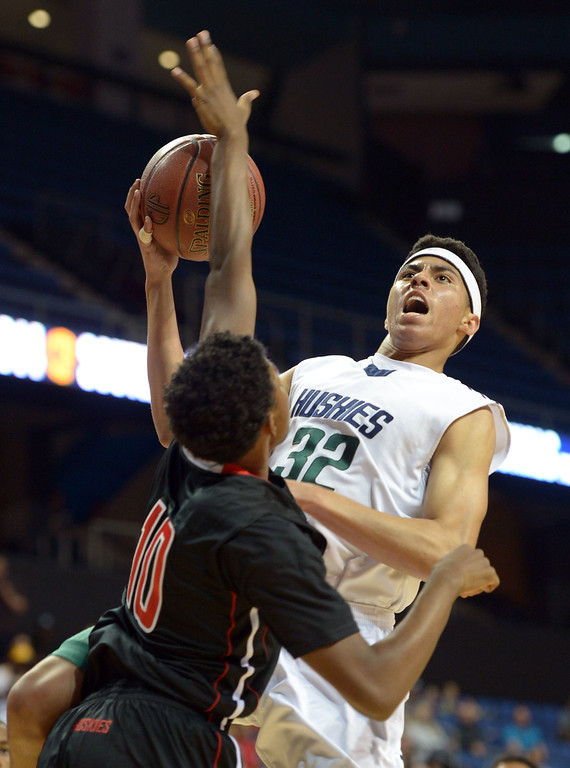 . Chino Hills\' Mark Williams is blocked by Centennial\'s Marcus Ford at Citizens Business Bank Arena in Ontario, CA on Saturday, March 22, 2014. Chino Hills vs Centennial in the CIF boys Div 1 regional final. 1st half. Photo by Scott Varley, Daily Breeze)