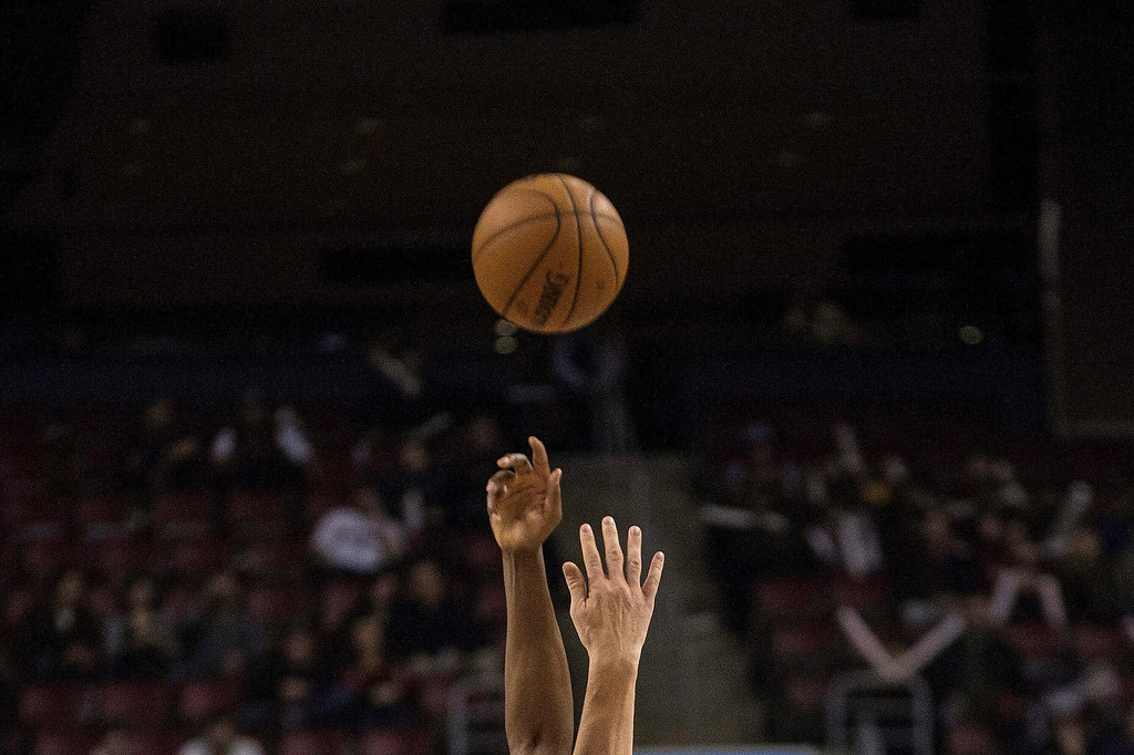 . Toronto Raptors\' Rudy Gay and Denver Nuggets\' Timofey Mozgov reach for the ball during the second half of an NBA basketball game on Sunday, Dec. 1, 2013, in Toronto. (AP Photo/The Canadian Press, Chris Young)