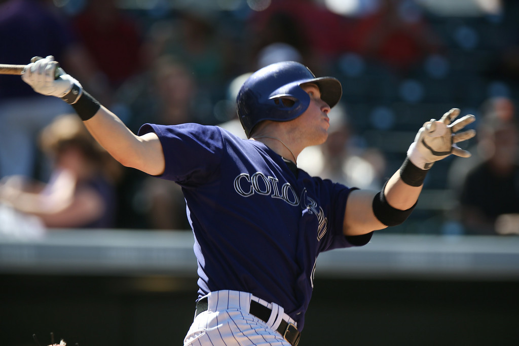. Colorado Rockies\' Corey Dickerson watches his solo home run against the San Francisco Giants in the fifth inning of the Rockies\' 9-2 victory in a baseball game in Denver on Wednesday, Sept. 3, 2014. (AP Photo/David Zalubowski)