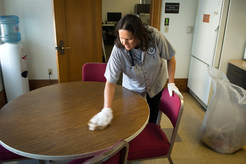 . Custodian Sanjuana Salas wipes down a table in an office break room at L.A. City Hall, Tuesday, March 18, 2014. (Photo by Michael Owen Baker/L.A. Daily News)