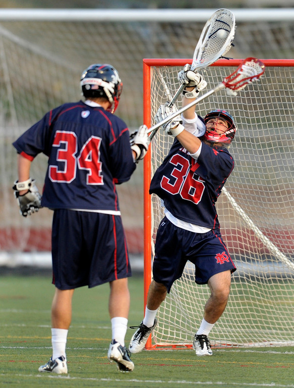 . AURORA, CO. - APRIL 24:  Sun Devils goalie Marcus Stears (36) made a save in the first half. The Regis Jesuit High School boy\'s lacrosse team defeated Kent Denver 10-8 Wednesday night, April 24, 2013. Photo By Karl Gehring/The Denver Post