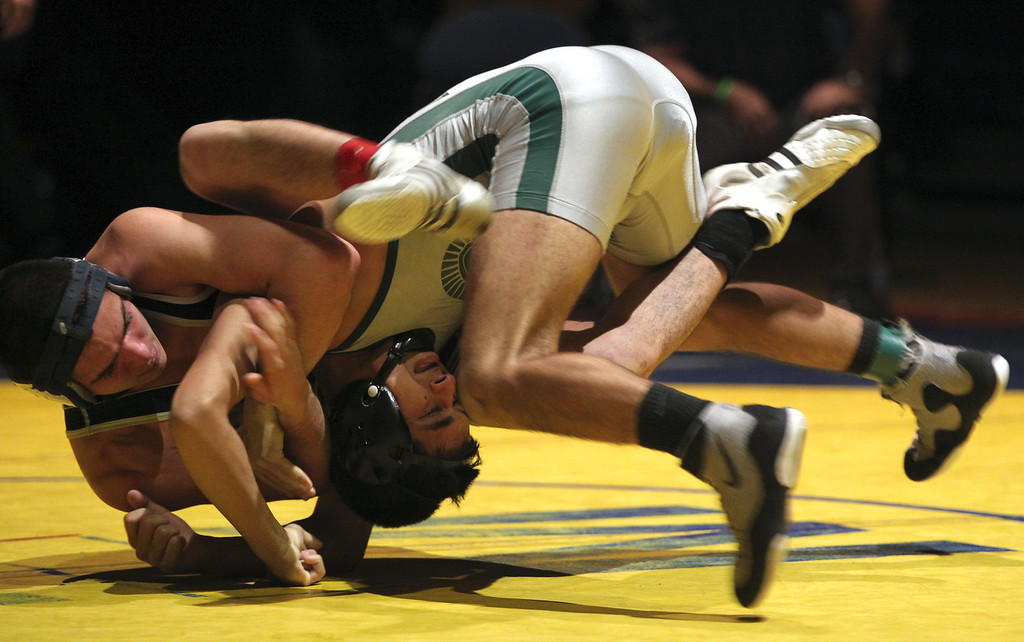 . Freedom\'s Ricky Coster, left, faces off against De La Salle\'s Nathan Cervantes in the 120-pound finals at the North Coast Section wrestling championships held at Newark Memorial High School in Newark, Calif., on Saturday, Feb. 23, 2013. Coster would get the win. (Anda Chu/Staff)