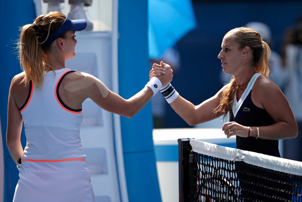 . Dominika Cibulkova of Slovakia, right,   shakes hands with Agnieszka Radwanska of Poland at the net after Cibulkova won their semifinal at the Australian Open tennis championship in Melbourne, Australia, Thursday, Jan. 23, 2014.(AP Photo/Rick Rycroft)