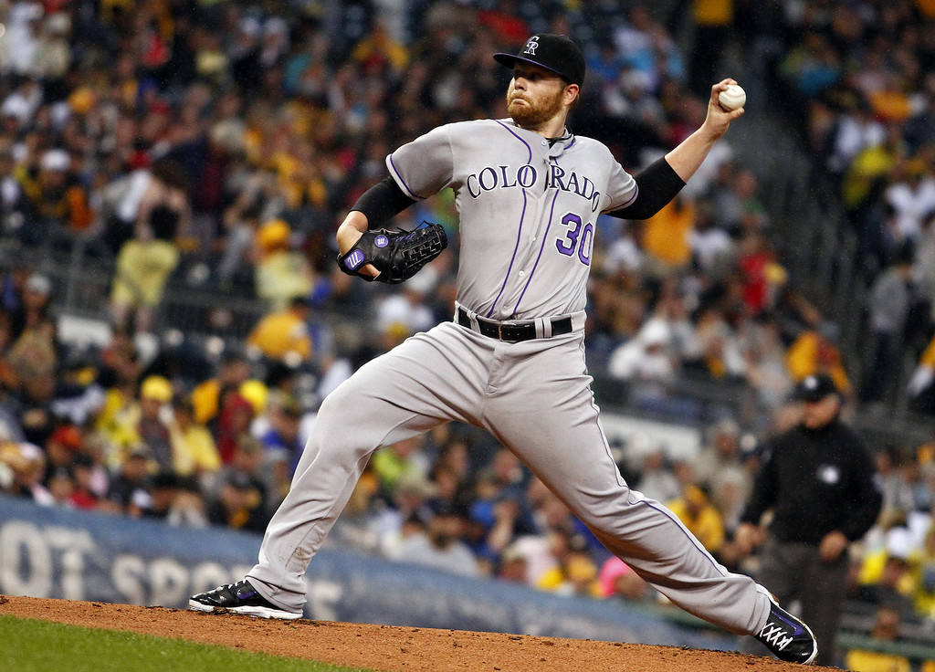 . PITTSBURGH, PA - JULY 19: Brett Anderson #30 of the Colorado Rockies pitches in the first inning against the Pittsburgh Pirates during the game at PNC Park July 19, 2014 in Pittsburgh, Pennsylvania. (Photo by Justin K. Aller/Getty Images)