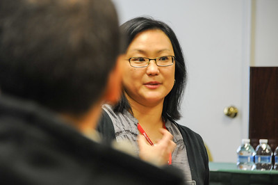 "JaeRan Kim helping to lead a workshop session titled ""Generations After Adoption: A Conversation with Adoptee Parents"""