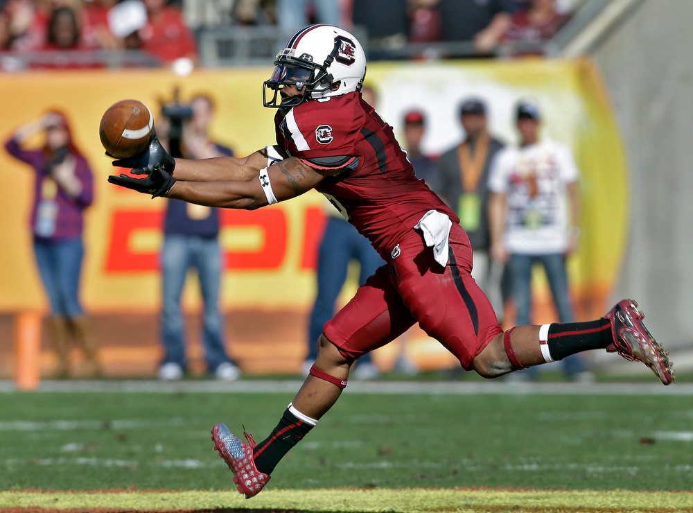 Description of . South Carolina wide receiver Nick Jones pulls in a pass during the first quarter of the Outback Bowl NCAA college football game against Michigan, Tuesday, Jan. 1, 2013, in Tampa, Fla. (AP Photo/Chris O'Meara)