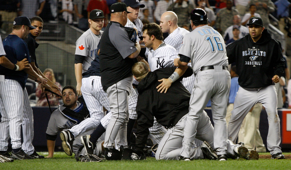 . New York Yankees and Toronto Blue Jays brawl on the field during the eighth inning of the Blue Jays 10-4 victory over the Yankees in their baseball game at Yankee Stadium Tuesday, Sept. 15, 2009 in New York.  Blue Jays catcher Rod Barajas, left, can be seen on the ground and Blue Jays third base umpire Nick Leyva (16) participates helping break it up. Yankees Nick Swisher is in the center of the group. (AP Photo/Kathy Willens)