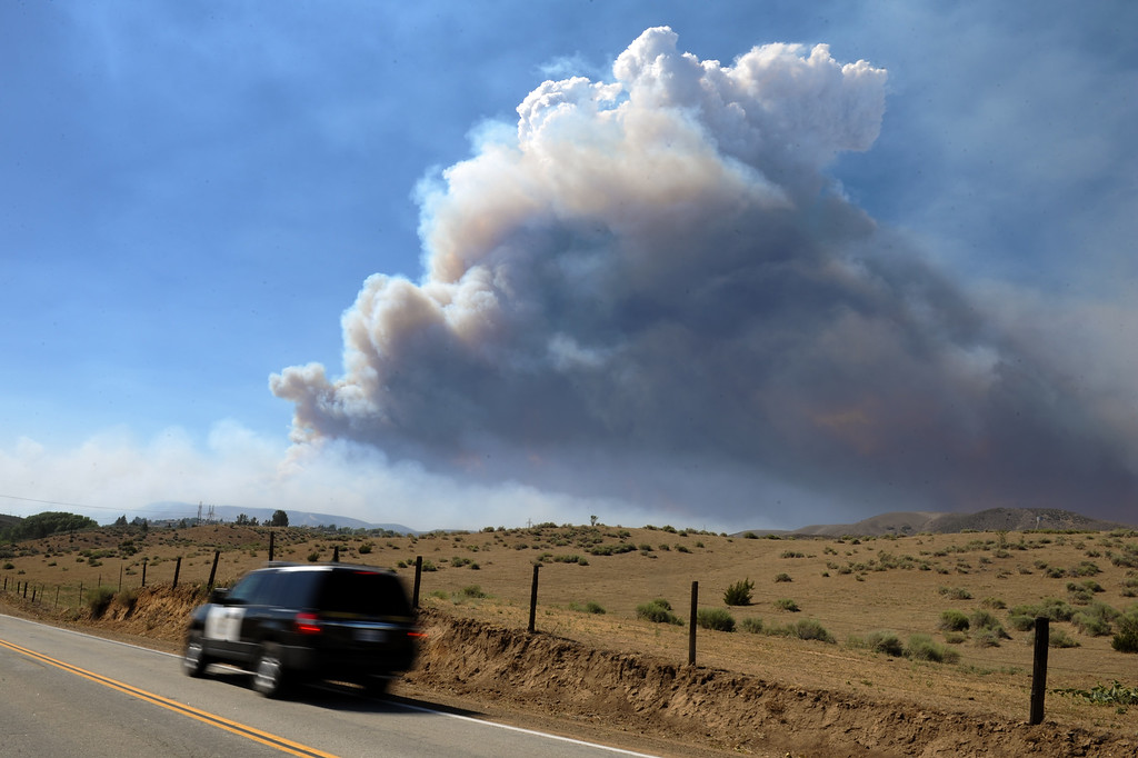 . A huge head of smoke billows from the Powerhouse Fire as seen from Elizabeth Lake Road, Sunday, June 2, 2013. (Michael Owen Baker/Staff Photographer)