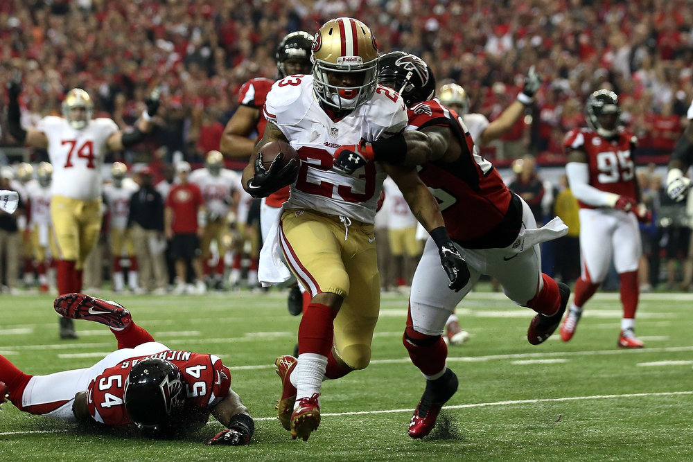 Description of . LaMichael James #23 of the San Francisco 49ers scores a 15-yard rushing touchdown in the second quarter against the Atlanta Falcons in the NFC Championship game at the Georgia Dome on January 20, 2013 in Atlanta, Georgia.  (Photo by Streeter Lecka/Getty Images)