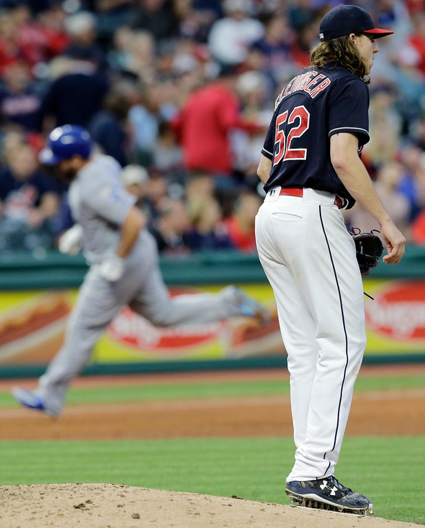 . Cleveland Indians starting pitcher Mike Clevinger, right, waits for Kansas City Royals\' Mike Moustakas, left, to run the bases after Moustakes hit a solo home run in the fifth inning of a baseball game, Friday, May 26, 2017, in Cleveland. (AP Photo/Tony Dejak)