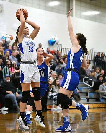 2/13/2020 Mike Orazzi | StaffrBristol Eastern's Sage Scarritt (25) and Lewis Mills' Grace Annonson (10) during Thursday night's girls basketball game in Bristol.