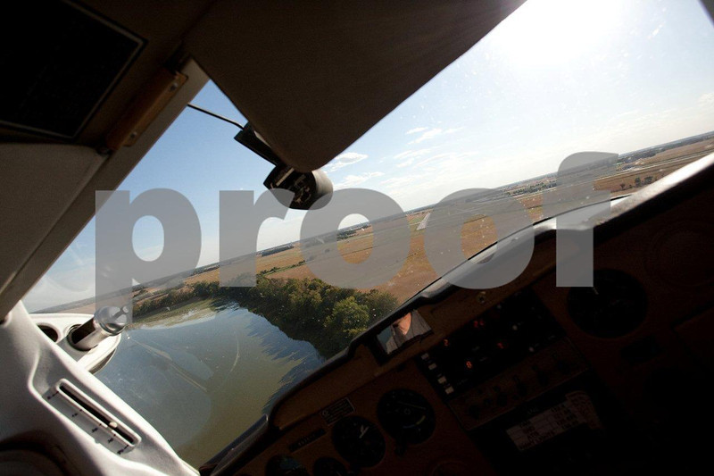 Young civilian pilot in a Cessna approaching the land strip.