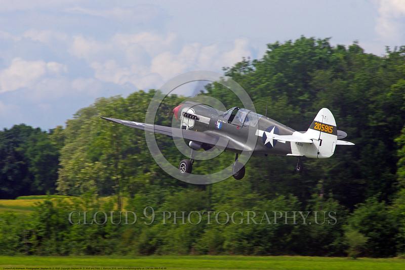 WB-Curtiss P-40 Warhawk 00046 A flying Curtiss P-40 Warhawk USA WWII era fighter warbird picture by Stephen W. D. Wolf.JPG