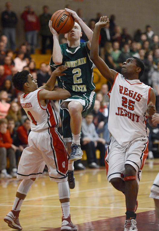 . LITTLETON, CO. - JANUARY 29: Mountain Vista drives to the basket on Regis Cam Beards (1) and Elijah Sanford (25) during their game January 29, 2013 at Regis.  (Photo By John Leyba / The Denver Post)