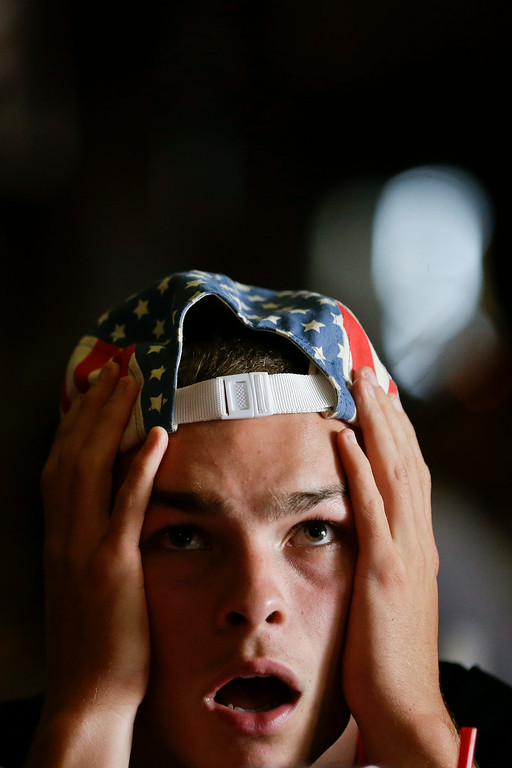 . Laramie Brown reacts as he watches the United States soccer team miss an opportunity to score during the World Cup round of 16 soccer match between Belgium and the U.S., Tuesday, July 1, 2014, in San Diego. (AP Photo/Gregory Bull)