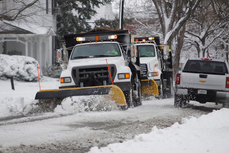 . Princeton road crews work to clear snow and ice off of Main Street in Gibson County, Ind. Wednesday afternoon, Dec. 26, 2012. The heavy snowfall in the area left many streets and highways dangerous to travel on. (AP Photo/Princeton Daily, Michael Caterina)