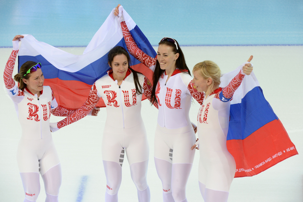 . (From L) Russia\'s Olga Graf, Russia\'s Ekaterina Shikhova, Russia\'s Ekaterina Lobysheva and Russia\'s Yuliya Skokova celebrate after the Women\'s Speed Skating Team Pursuit Final at the Adler Arena during the Sochi Winter Olympics on February 22, 2014. (DAMIEN MEYER/AFP/Getty Images)