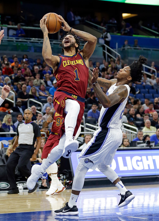 . Cleveland Cavaliers\' Derrick Rose (1) goes up for a shot past Orlando Magic\'s Elfrid Payton during the first half of an NBA preseason basketball game, Friday, Oct. 13, 2017, in Orlando, Fla. (AP Photo/John Raoux)