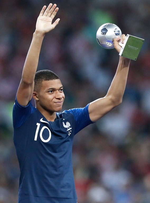 . France\'s Kylian Mbappe holds the award for best young player at the end of the final match between France and Croatia at the 2018 soccer World Cup in the Luzhniki Stadium in Moscow, Russia, Sunday, July 15, 2018. France won 4-2. (AP Photo/Petr David Josek)