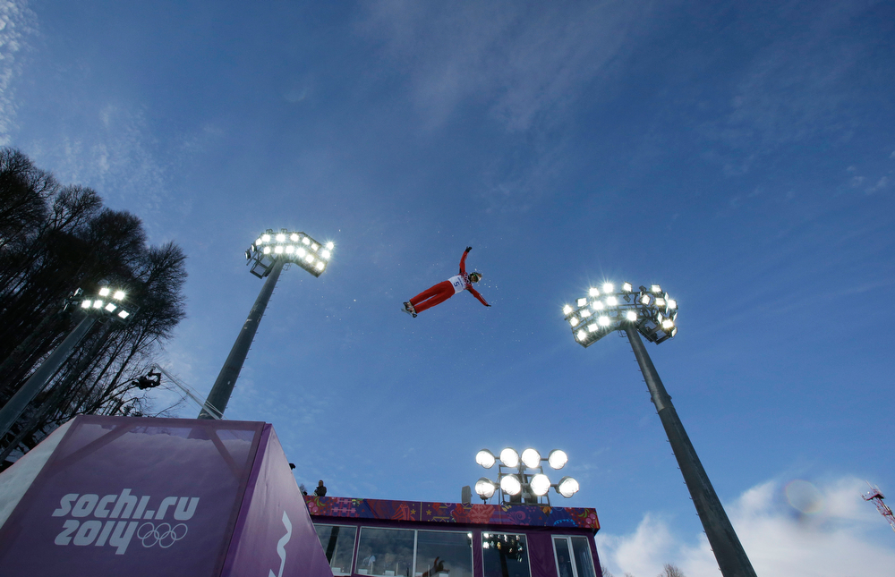 . China\'s Cheng Shuang jumps during women\'s freestyle skiing aerials training at the Rosa Khutor Extreme Park, at the 2014 Winter Olympics, Friday, Feb. 14, 2014, in Krasnaya Polyana, Russia. (AP Photo/Greg Baker)