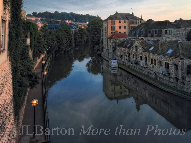 Bath Morning Dawn in Bath, UK.  This shot had some tonal contrast processing to pick up the details, but the light is 'original' - warm tones on the Bath Stone.  This is (one of) the River Avon.