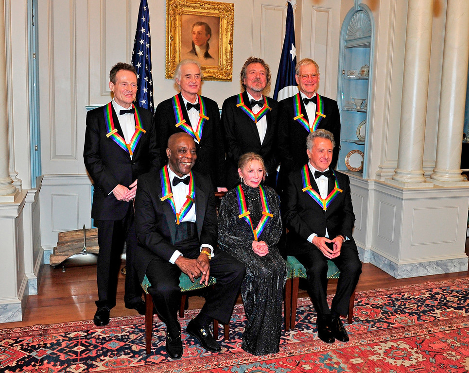 . WASHINGTON, DC - DECEMBER 1:  (L-R Back Row)  John Paul Jones, Jimmy Page, Robert Plant, David Letterman (L-R Front Row) U.S. Secretary of State Hillary Rodham Clinton, Buddy Guy, Natalia Makarova, Dustin Hoffman pose following a dinner for Kennedy honorees hosted by U.S. Secretary of State Hillary Rodham Clinton at the U.S. Department of State on December 1, 2012 in Washington, DC.  (Photo by Ron Sachs - Pool/Getty Images)