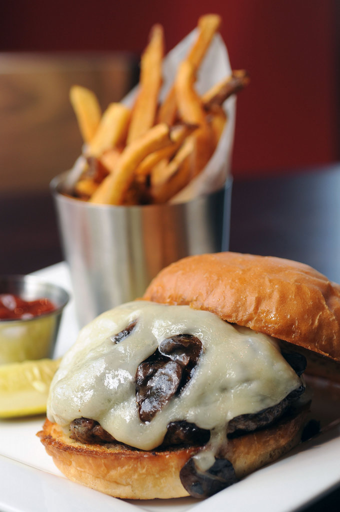. The Mushroom-Swiss Burger served with fries.  (Pioneer Press: Scott Takushi)