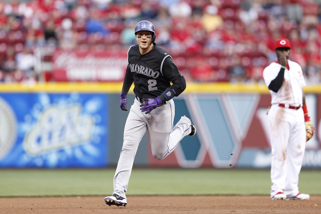 . CINCINNATI, OH - MAY 9: Troy Tulowitzki #2 of the Colorado Rockies rounds the bases after hitting a home run in the top of the fourth inning of the game against the Cincinnati Reds at Great American Ball Park on May 9, 2014 in Cincinnati, Ohio. (Photo by Joe Robbins/Getty Images)