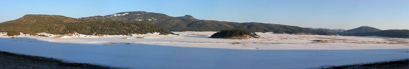 Valles Caldera at sunrise, April 9, 2005.  Panorama merged from 9 handheld images; Canon 20D; Canon 17-40 mm @, 40; 1/250, f/10