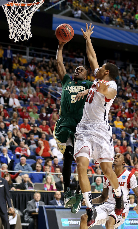 . LEXINGTON, KY - MARCH 23: Jon Octeus #5 of the Colorado State Rams drives to the basket against Wayne Blackshear #20 of the Louisville Cardinals in the first half during the third round of the 2013 NCAA Men\'s Basketball Tournament at Rupp Arena on March 23, 2013 in Lexington, Kentucky.  (Photo by Andy Lyons/Getty Images)