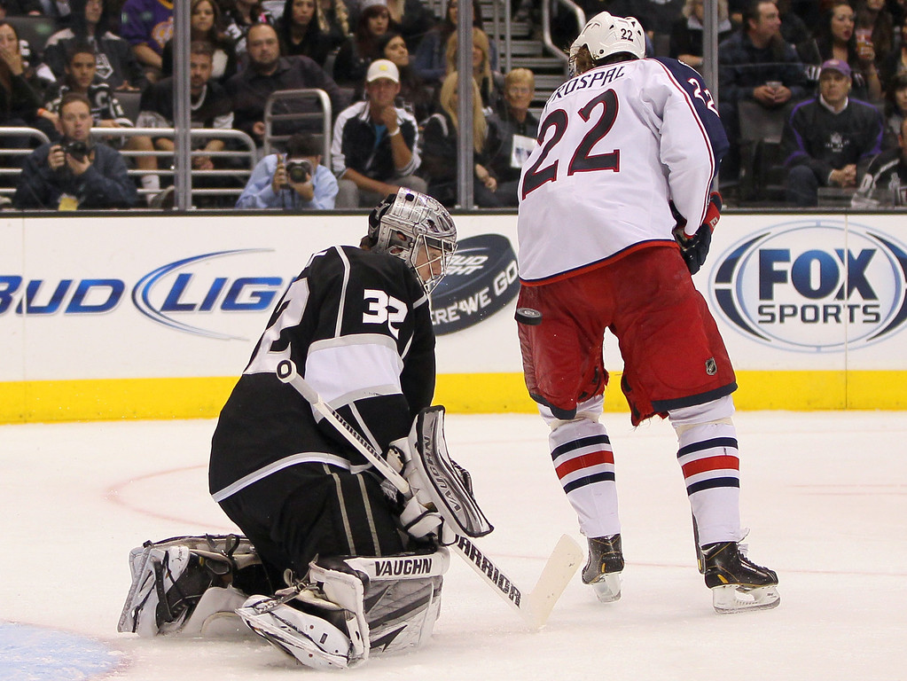 . LOS ANGELES, CA - APRIL 18:  Vinny Prospal #22 of the Columbus Blue Jackets sets a screen in front of goaltender Jonathan Quick #32 of the Los Angeles Kings as Quick makes a save in the third period of the NHL game at Staples Center on April 18, 2013 in Los Angeles, California. The Kings defeated the Blue Jackets 2-1.  (Photo by Victor Decolongon/Getty Images)