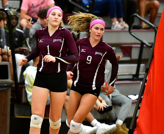 10/1/2019 Mike Orazzi | StaffrBristol Central's Jadyn Bauer (1) and Ashleigh Clark (9) during Tuesday's volleyball match with Platt at BC.