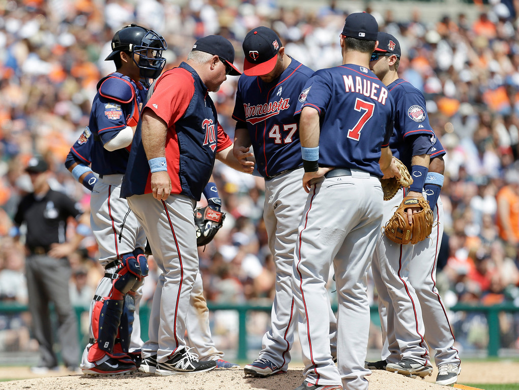 . Minnesota Twins pitcher Ricky Nolasco (47) is relieved by manager Ron Gardenhire in the sixth inning of a baseball game against the Detroit Tigers in Detroit, Sunday, June 15, 2014. (AP Photo/Paul Sancya)