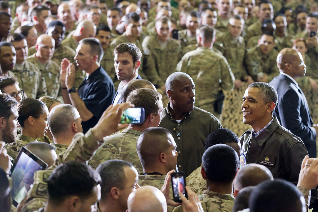 . President Barack Obama greets troops at Bagram Air Field, north of Kabul, Afghanistan, during an unannounced visit on Sunday, May 25, 2014. (AP Photo/ Evan Vucci)