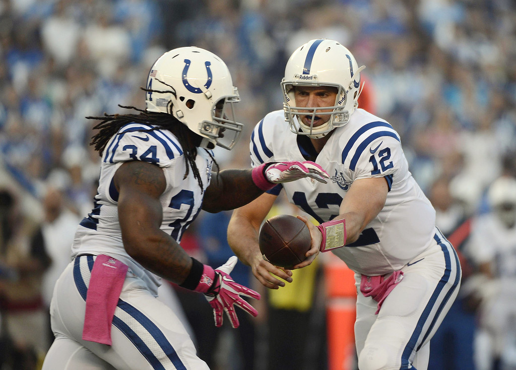 . Andrew Luck #12 hands off the ball to Trent Richardson #34 of the Indianapolis Colts during the game against the San Diego Chargers on October 14, 2013 at Qualcomm Stadium in San Diego, California. (Photo by Donald Miralle/Getty Images)