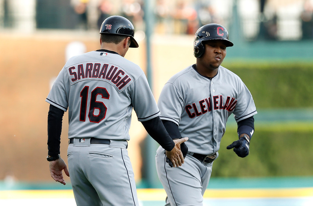 . Cleveland Indians\' Jose Ramirez, right, celebrates his solo home run with third base coach Mike Sarbaugh (16) against the Detroit Tigers in the first inning of a baseball game in Detroit, Monday, May 14, 2018. (AP Photo/Paul Sancya)