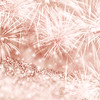 Silver and Rose gold fireworks and bokeh on gliter paper at New Year and copy space. Abstract background holiday.