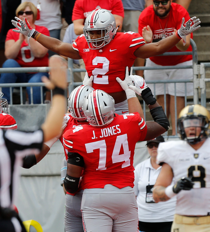 . Ohio State running back J.K. Dobbins, top, celebrates his touchdown against Army during the first half of an NCAA college football game Saturday, Sept. 16, 2017, in Columbus, Ohio. (AP Photo/Jay LaPrete)